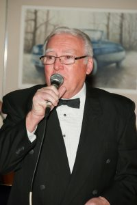 Otsego Jazz Ensemble vocalist Ian Brown at a wedding gig in the Gilmore Car Museum in Hickory Corners, Michigan