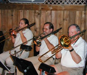 Otsego Jazz Ensemble trombone section performing with the band at the former Bay Pointe Restaurant